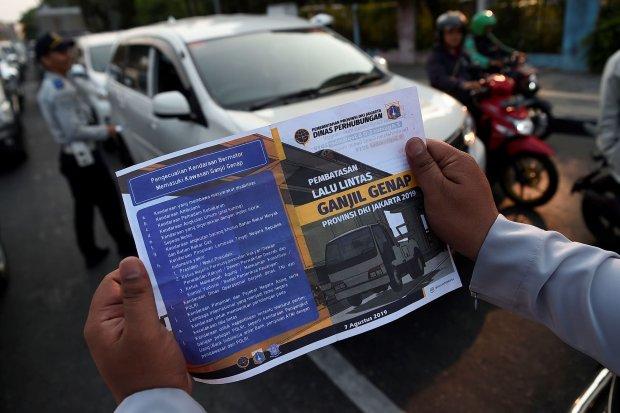 grab, aturan ganjil genap, taksi online, penurunan pendapatan