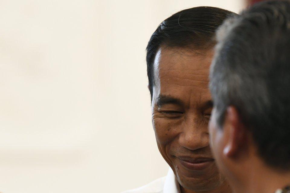 Jokowi, UU KPK, DPR.