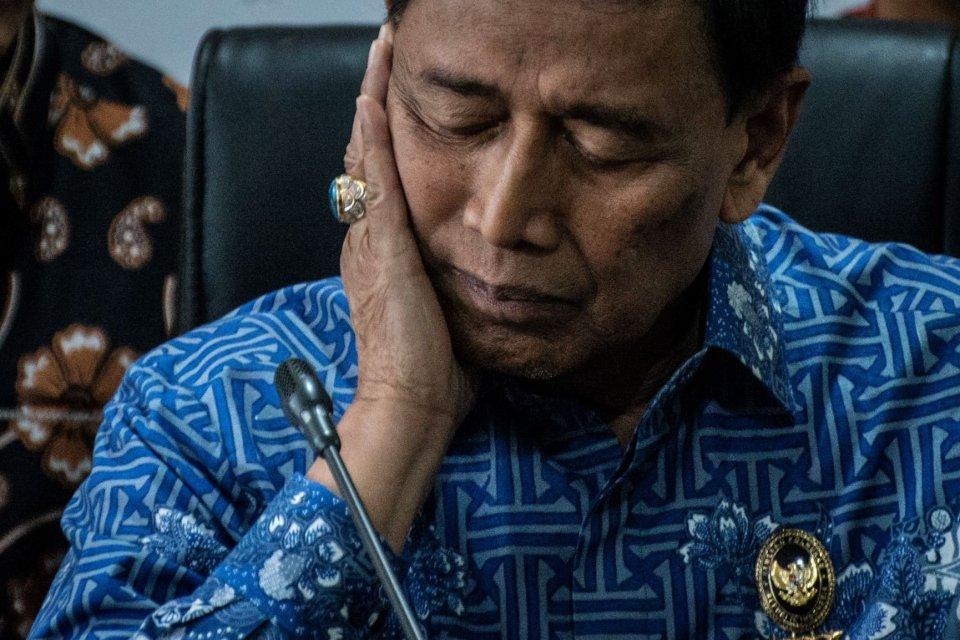Menko Polhukam Wiranto seusai memberikan keterangan pers terkait klarifikasi pernyataan tentang gempa Maluku, di Media Center Kantor Kemenko Polhukam, Jakarta, Jumat (4/10/2019).