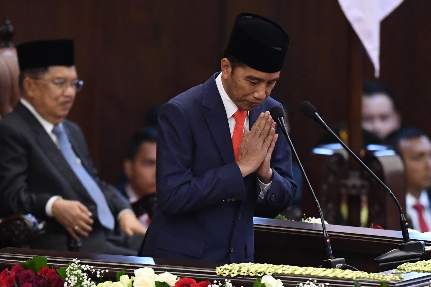 Presiden Joko Widodo memberikan salam usai memberikan pidato awal masa jabatan presiden periode 2019-2024. Penerbitan Perppu KPK menjadi ujian Jokowi perihal komitmennya terhadap pemberantasan korupsi.