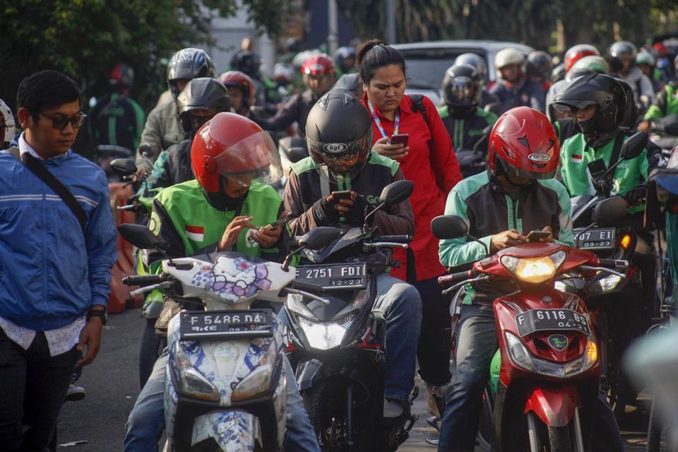 gojek dan grab Dinilai Tak Transparan, DPR Akan Telusuri Pajak Pengemudi Ojek Online