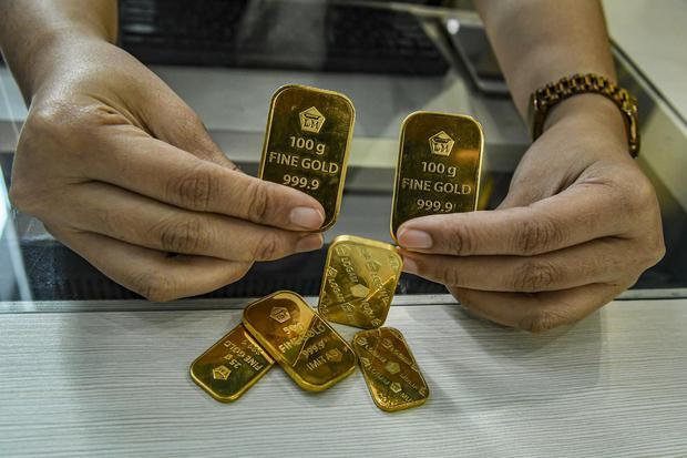 Ilustrasi, emas batangan produksi PT Aneka Tambang Tbk. Harga emas Antam stabil di level Rp 938.000 per gram meski di pasar spot ada aksi profit taking.