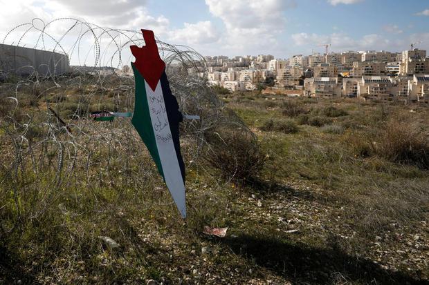Sebuah peta representasi dengan warna bendera Palestina yang bertuliskan