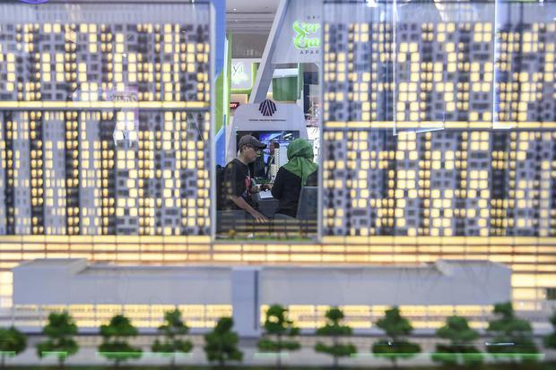 Maket apartemen saat pameran hunian Indonesia Property Expo 2020 di Jakarta Convention Center, Senayan, Jakarta, Sabtu (15/2/2020). Disahkannya UU Cipta Kerja membuat WNA boleh memiliki apartemen di Indonesia.