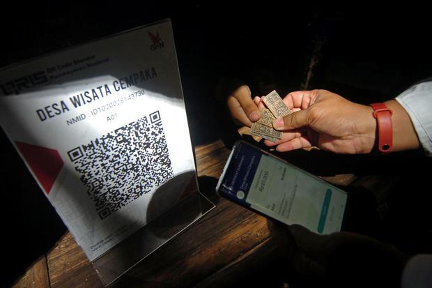 biaya transaksi, merchant discount rate, transaksi nontunai, kode pembayaran standar BI, QRIS