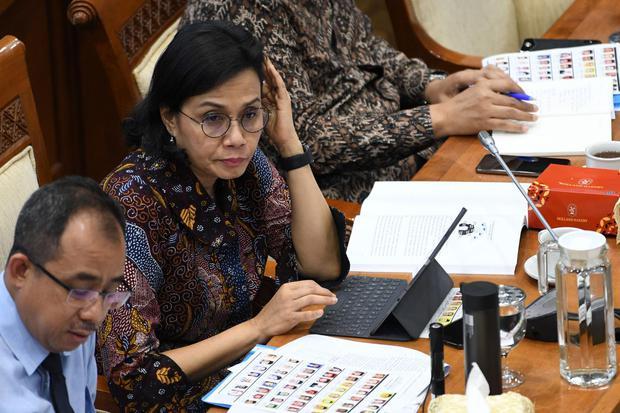 sri mulyani, menteri keuangan, burden sharing, pandemi corona, utang, surat utang, bunga surat utang