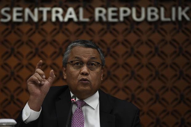 Gubernur Bank Indonesia Perry Warjiyo. BI mencatat dari total cadangan SBN perbankan sebesar Rp 886 triliun ada Rp 563,6 triliun yang bisa direpokan sebelum meminta bantuan dana restrukturisasi.