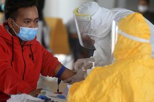 RAPID TEST PEKERJA MIGRAN INDONESIA ASAL MALAYSIA