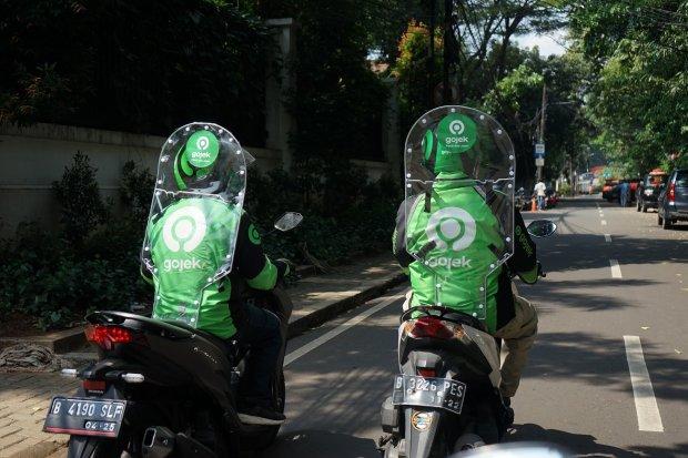 Ilustrasi, pengemudi Gojek menggunakan partisi