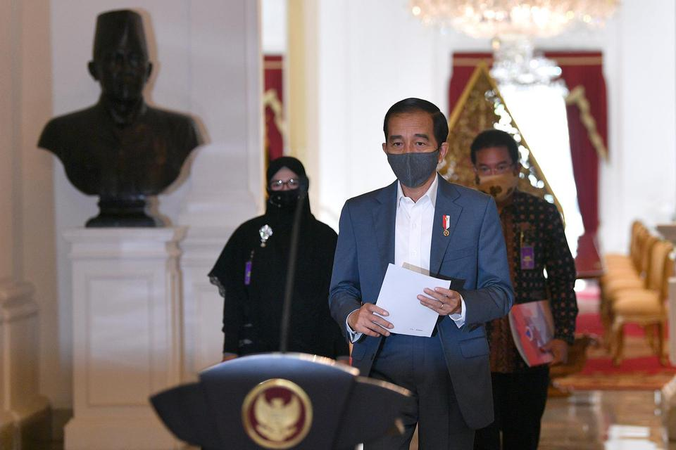 Ilustrasi, Presiden Joko Widodo (Jokowi). Jokowi meminta seluruh pihak berhati-hati menangani krisis akibat pandemi corona agar upaya penanganan kesehatan dan ekonomi mampu berjalan beriringan.