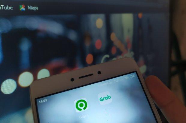 Saingi Gojek, Grab Gandeng Qasir Sediakan Kasir Digital untuk UMKM